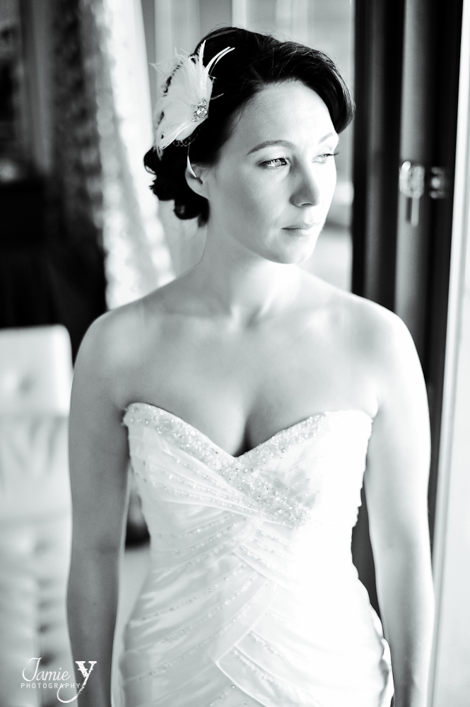 bride looking out the window when getting ready in her las vegas hotel room a the cosmopolitan