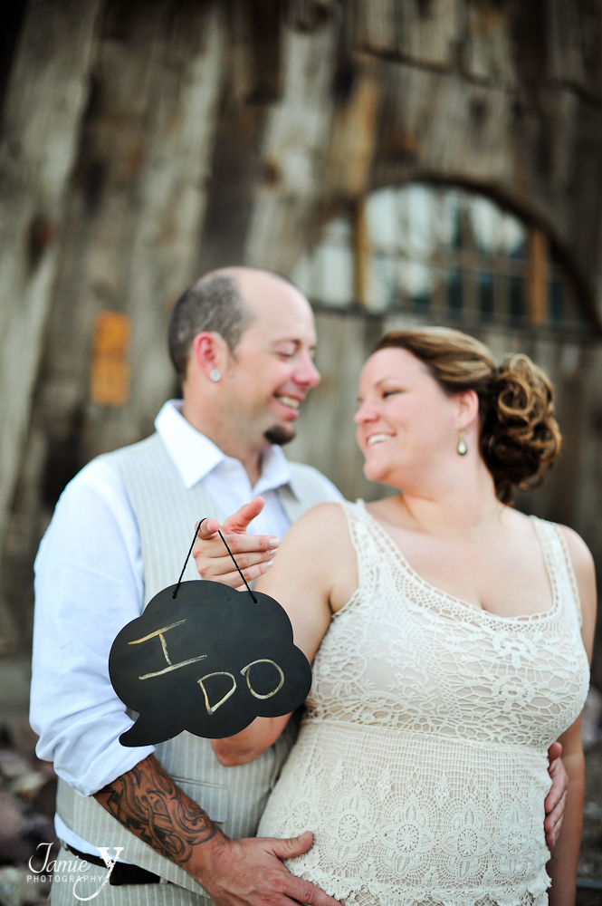 bride and groom picture with a chalkboard sign that says I do