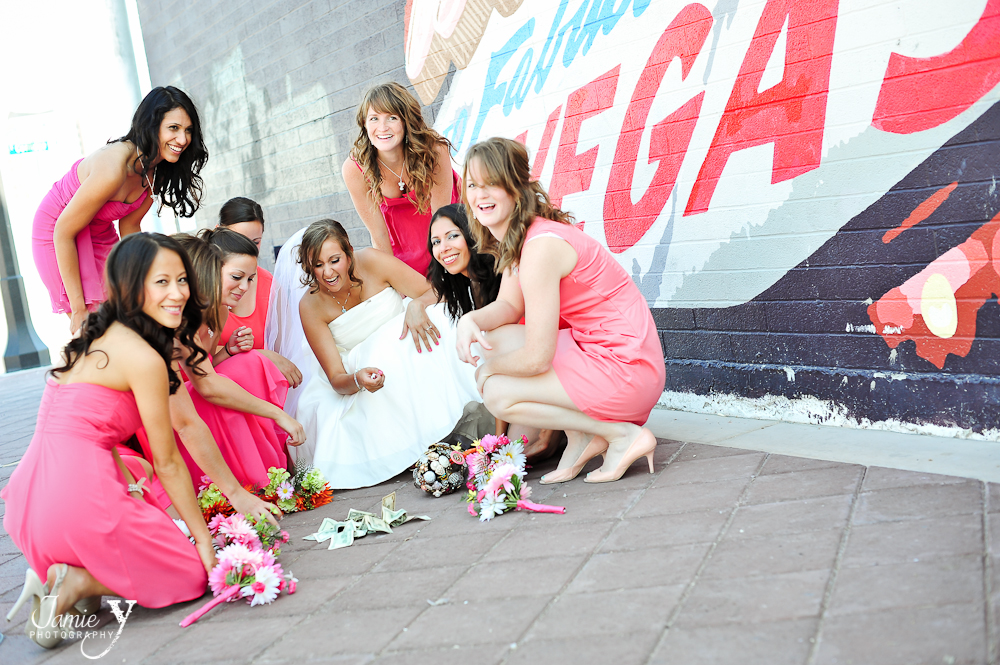 fun bridal party picture with them playing craps on the corner