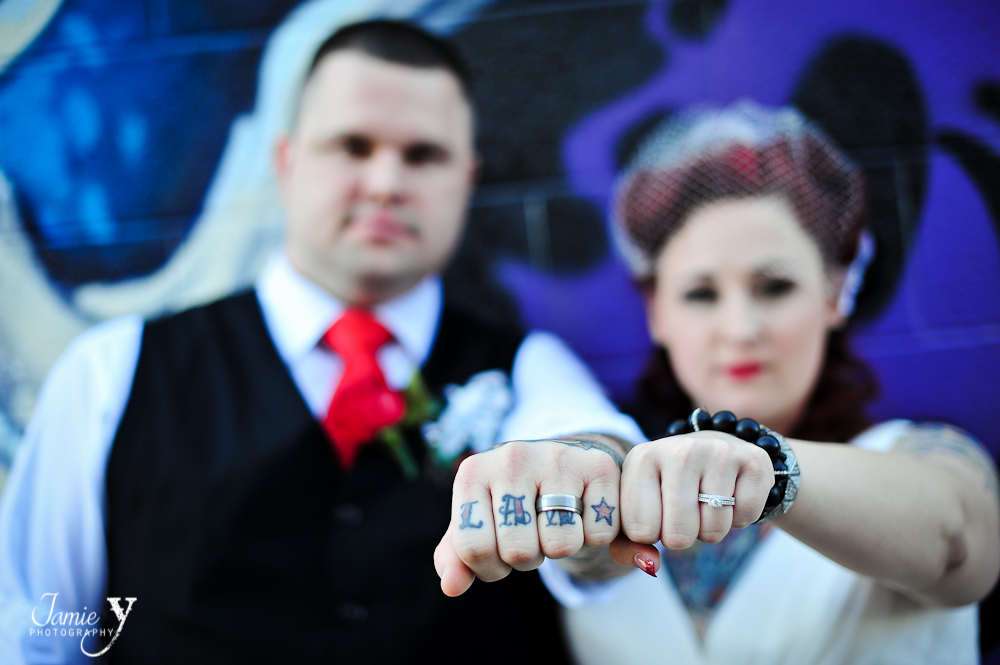 wedding ring picture with tattooed hand